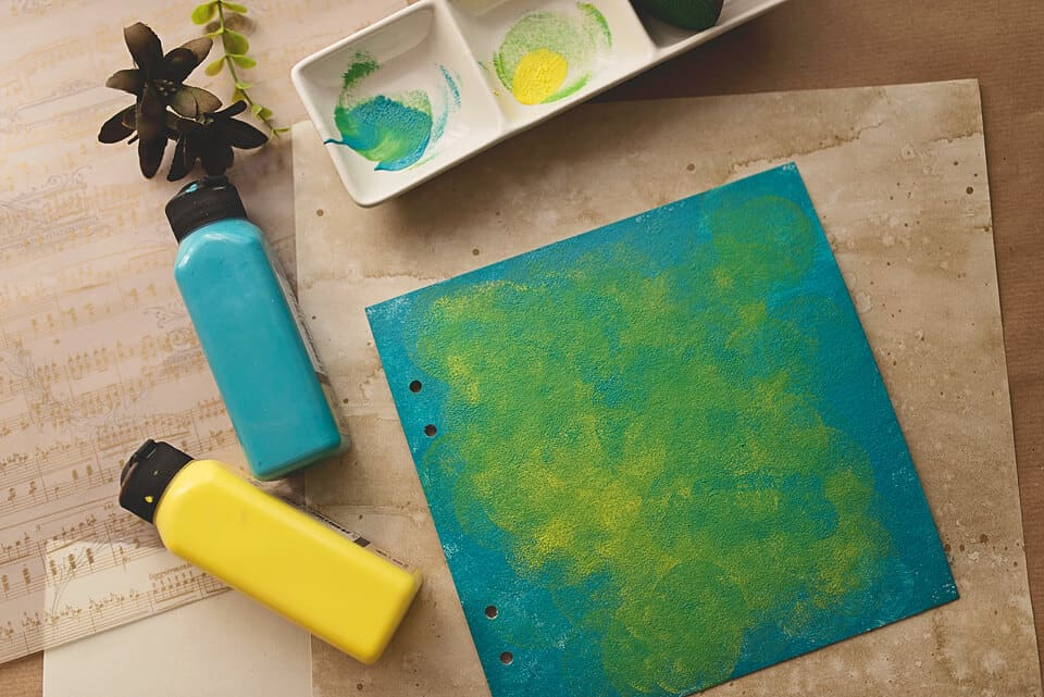 A PHOTO OF THE COVER FOR A DIY ART JOURNAL PAINTED IN BLUE AND YELLOW