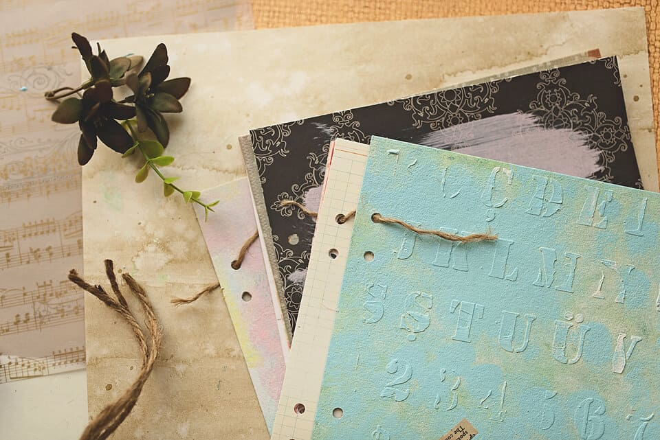 A PHOTO OF BINDING A DIY ART JOURNAL WITH A TWINE