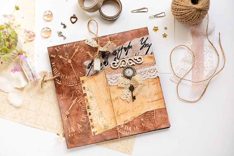 DIY photo album in vintage colors: brown, beige and light purple, with embellishments