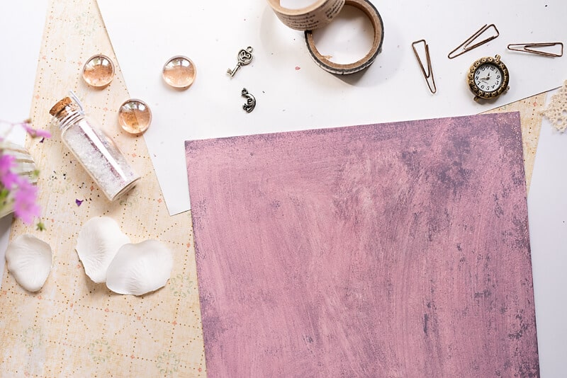 The cover of the DIY photo album covered in purple
