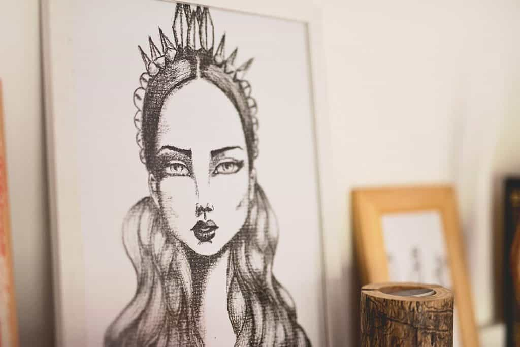 a drawing of a girl on a shelf
