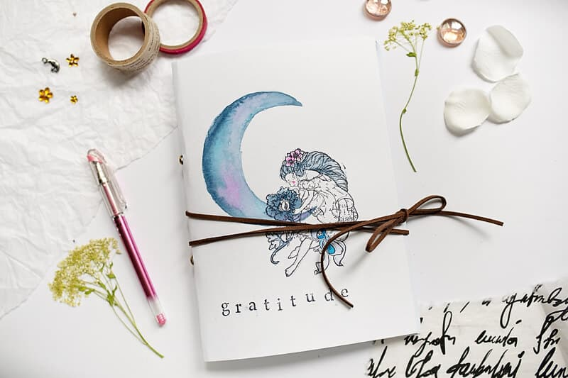 handmade gratitude journal on a table