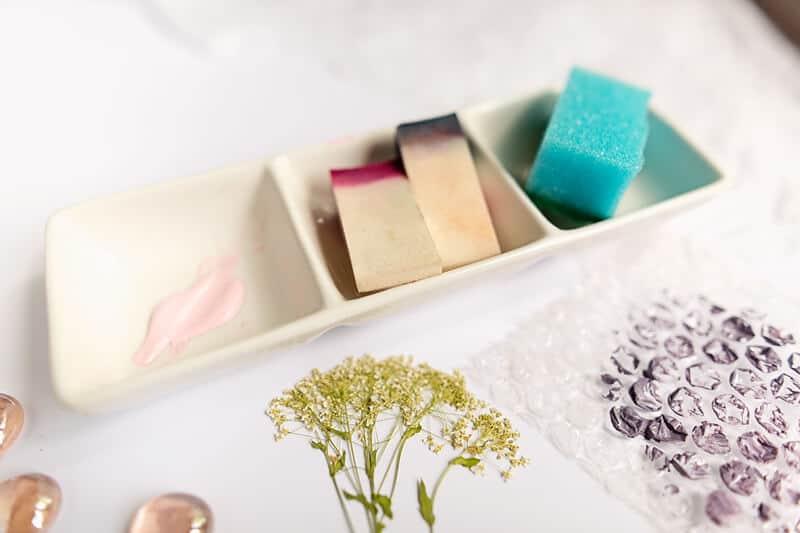 paint palette, a kitchen sponge and make-up sponges