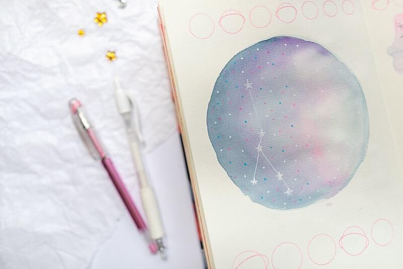 art journal page with a watercolor galaxy