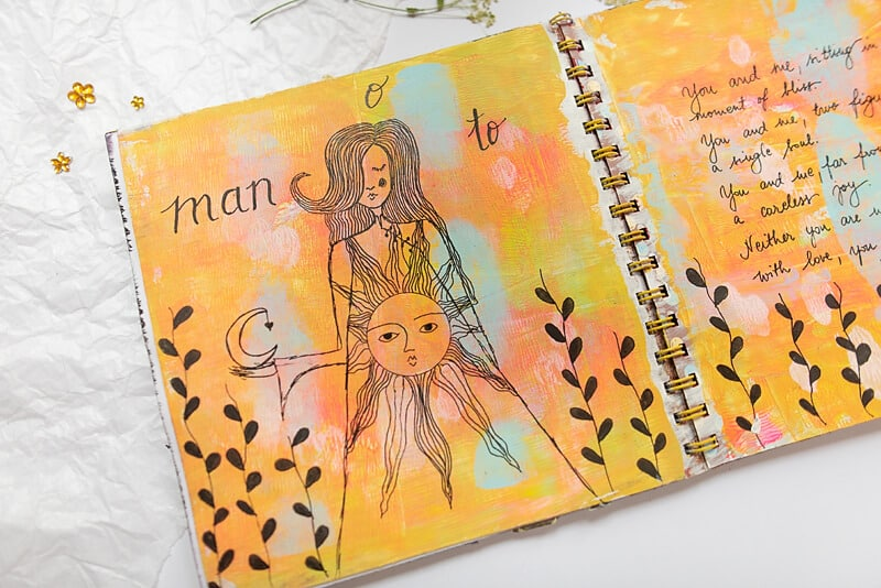 art journal page with a girl drawing