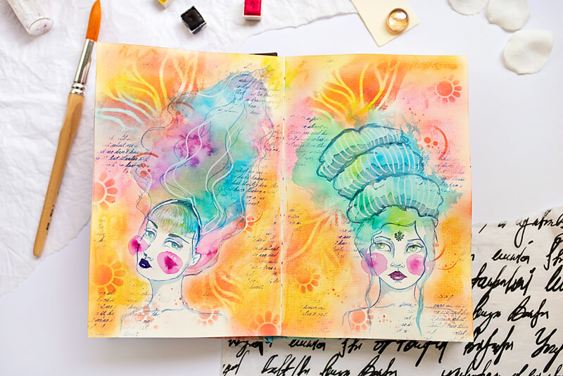art journal spread with two drawn girls