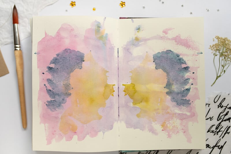 ART JOURNAL SPREAD WITH WATERCOLOR BACKGROUND
