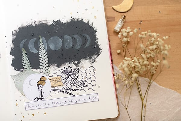 art journal page with moon stencil