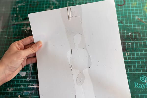 hand holding a diy printable stencil