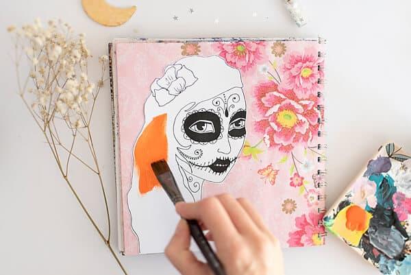 hand painting a sugar skull girl