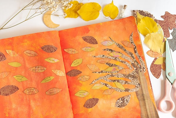 fall tree collage and leaves in an art journal