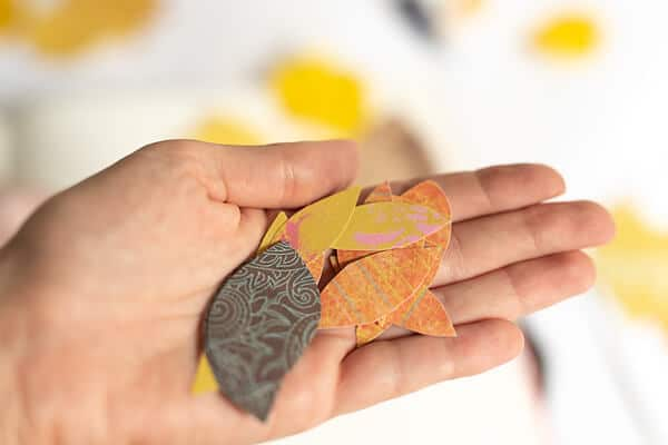 hand holding paper leaves