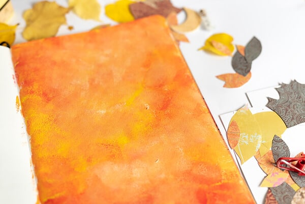 fall collage background in orange and red paint