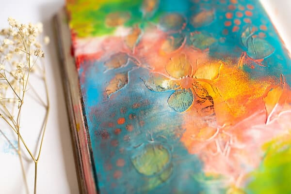 close-up of mixed media art journal page