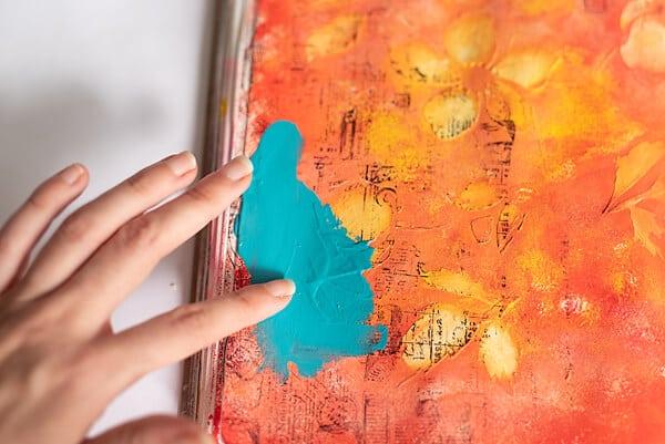 finger painting in an art journal