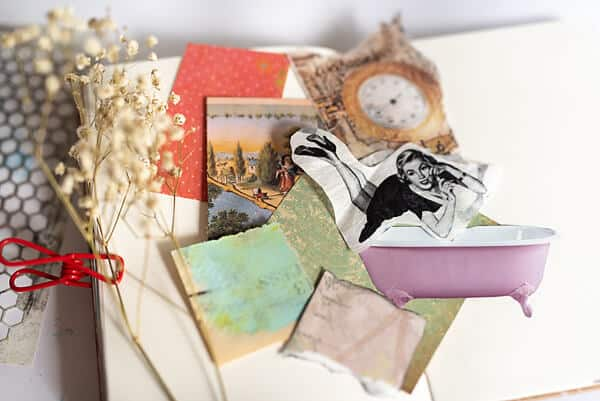 paper scraps on art journal spread