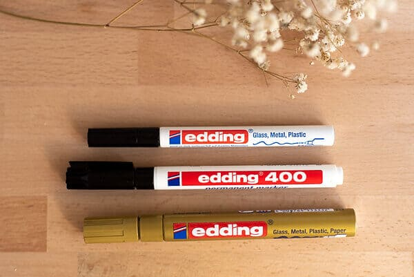 three edding markers