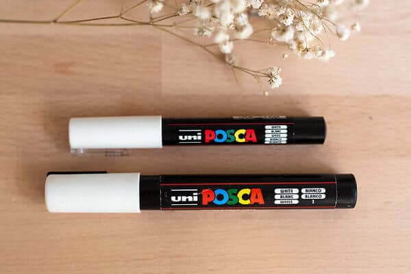 two white posca pens