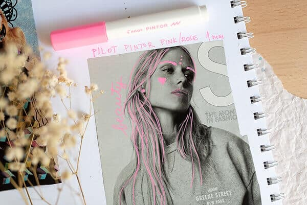 pink marker doodles on a magazine page
