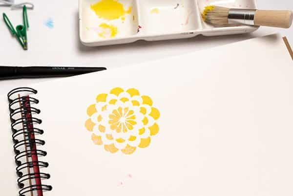 a flower painted with acrylic paint and a stencil