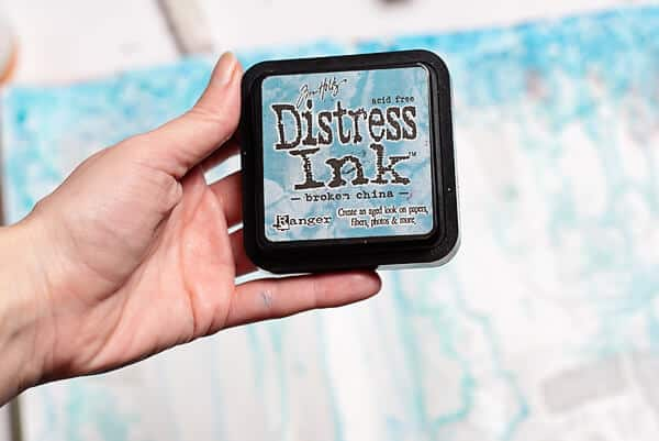 hand holding blue distress ink pad