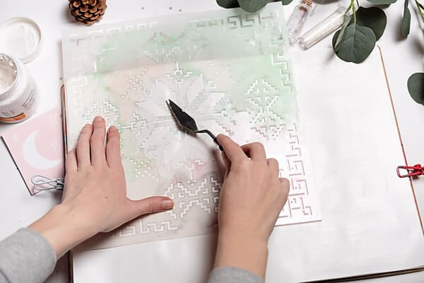 applying texture paste over a stencil
