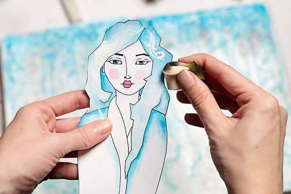 distressing a paper girl with sponge and ink