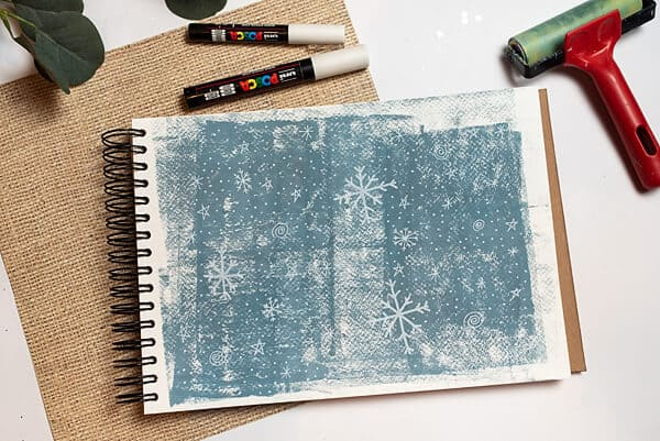 snowflakes doodles on blue background