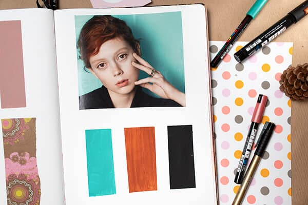 color palette inspiration board in an art journal