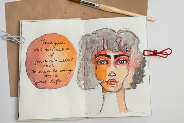 watercolor painting of a girl in an art journal