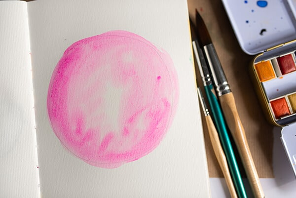 watercolor circle in an art journal
