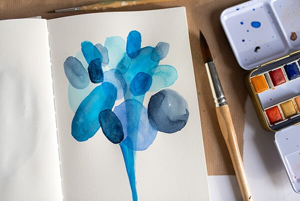 blue watercolor painting in an art journal