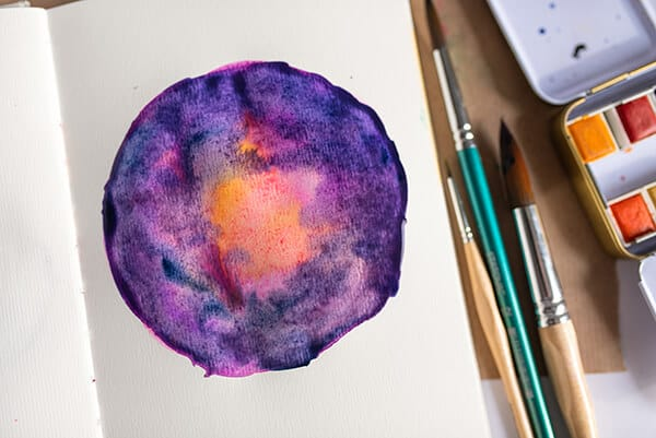 watercolor galaxy painting in an art journal