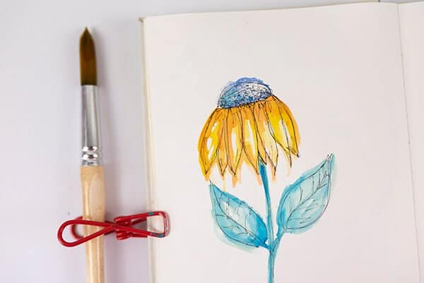 watercolor flower on art journal page