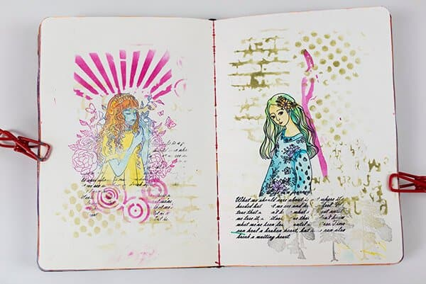 art journal spread with stamped images
