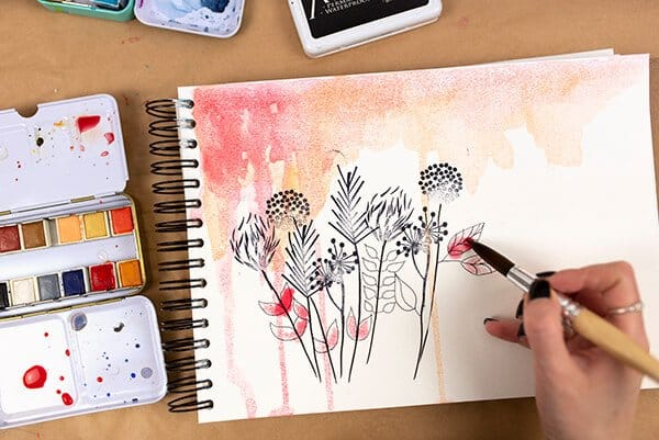 painting the leaves with watercolor
