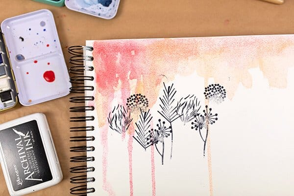 stamped flowers on watercolor