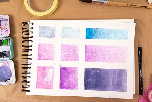 watercolor shapes in an art journal