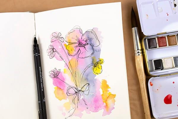 sketched flowers on watercolor