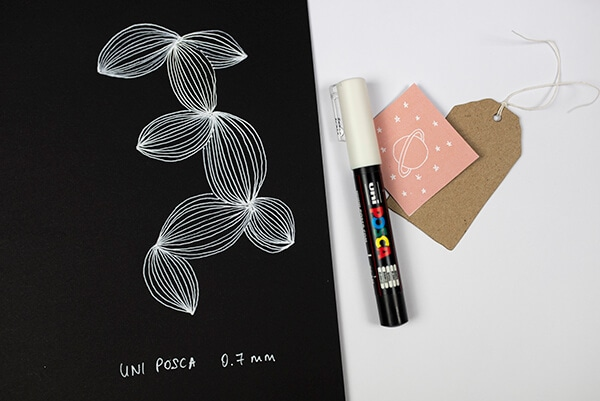 white posca pen on black paper